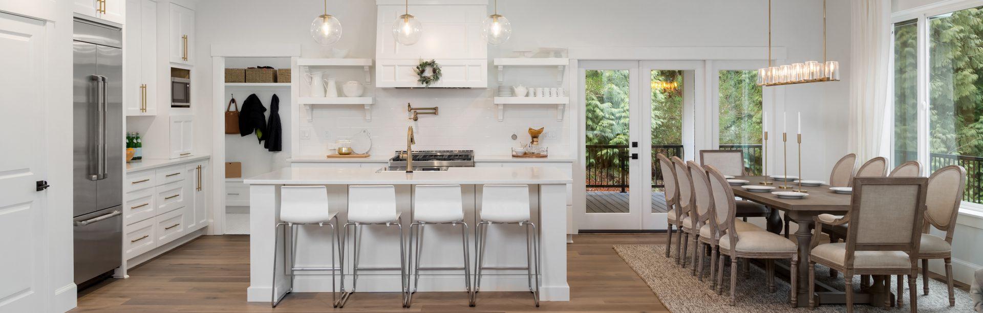white kitchen with light hardwood floors