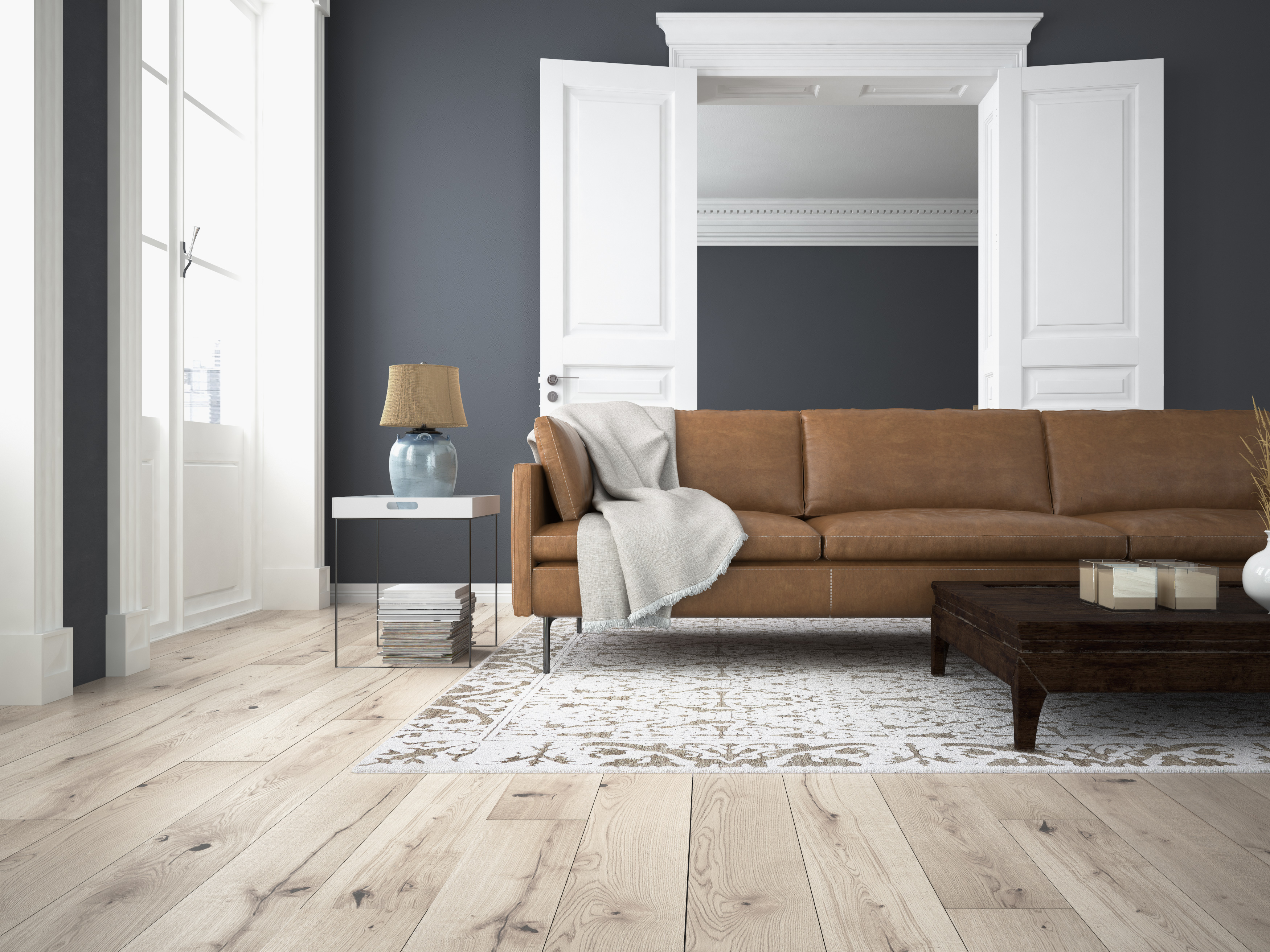 Living Room with Brown Couch and Light Wood Flooring