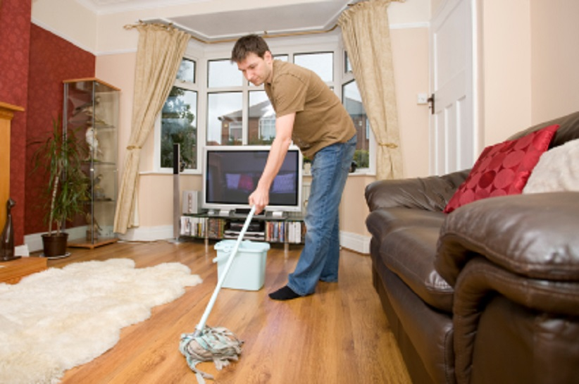 Man mopping floor
