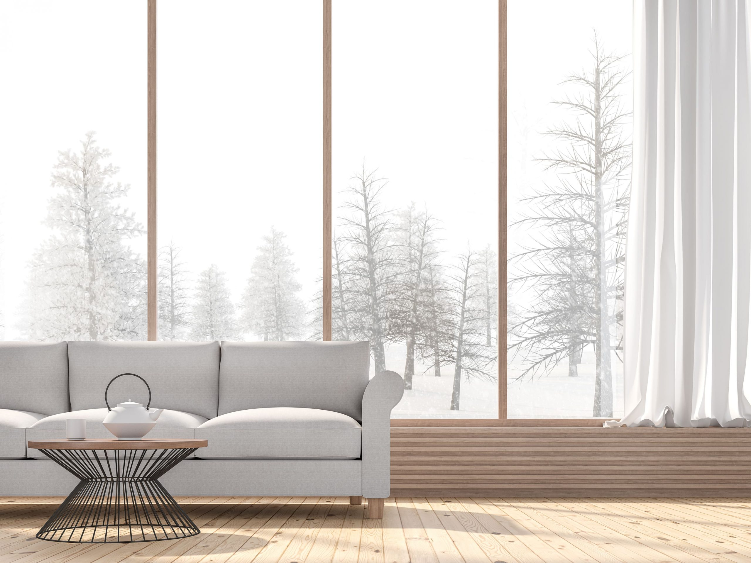 living room with hardwood flooring and window with snow falling outside