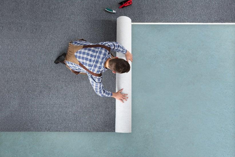 man rolling carpet