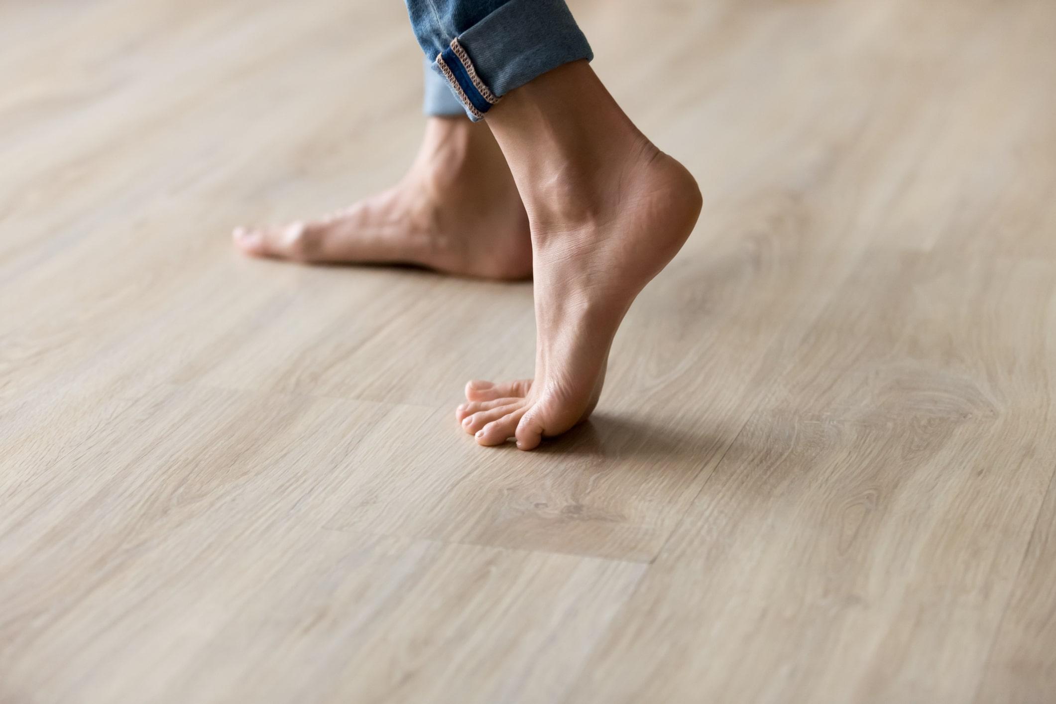 Feet Walking on Wood Floors