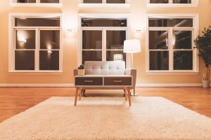 room with wood floors and gray loveseat